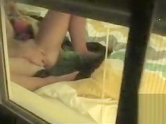 Naked neighbor masturbates in her bedroom