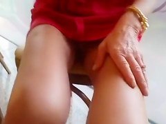 Upskirt woman models her mature vagina in public