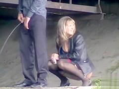 Desperate couple goes pee in public