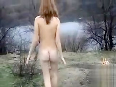 Russian beauty in heels peeing on frozen lake