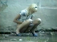 Teen blonde in a dress pees in public