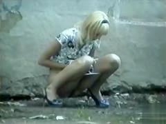 Teen blonde in a dress pees in public