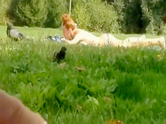 Jacking off to a tanning babe in the grass