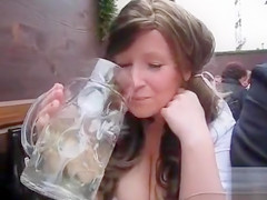 Fest girl makes water into a mug and takes a sip
