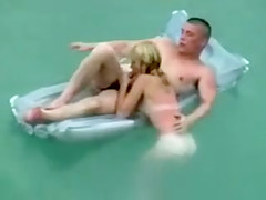 Naked couple floats in the ocean and fucks on the beach
