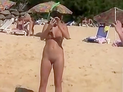 Naked models have fun on a beach vacation