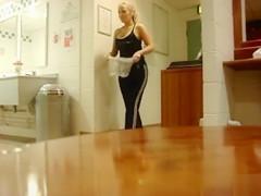 Pretty blonde takes a piss into the nylon bag
