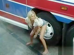 Blonde girl makes a big puddle in public