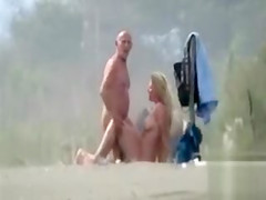 Bald man pounding his large-breasted lady in a pasture