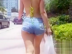 Cutie in denim shorts shakes her booty in public