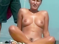 Nudist queen with perky tits sitting on the sand