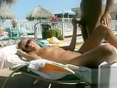 Poolside handjob and sex with tanned lovers