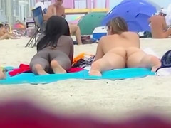 Naked black and white women filmed at the beach