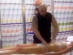 Massage demonstration on a slender girl in panties