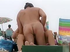 Nude beach couple has some flirty fun
