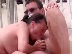 French mature couple boldly has sex at the beach