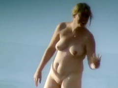 Milf with saggy tits goes skinny dipping in the ocean