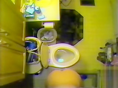 Ceiling cam films her naked in the bathroom