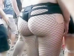 Girl at a concert with a hot butt in fishnets