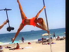 Blonde lass doing her pole dancing show