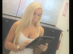 Downblouse at the store with a hot blonde chick