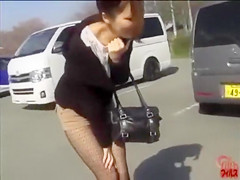 Fashionable Japanese doll pees her shorts outdoors