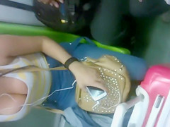 Big natural tits cleavage on the subway
