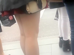Lovely legs on a coed in a red skirt