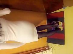 Skinny girl piddles in her black pantyhose