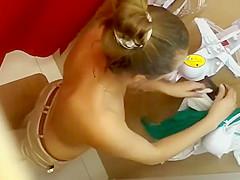 Dressing room spy films a girl trying on bras