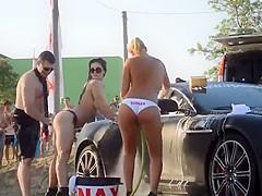 Topless goddesses washing the car