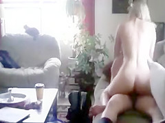 Attractive woman trips a tough penis about the sofa properl