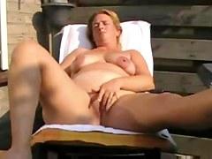 bulky housewife fingering on the veranda