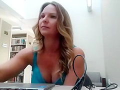 Big breasted blonde mom sensually touches herself in a publ