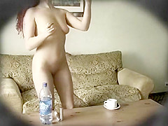 Gorgeous young chick loves to put on her makeup while in th