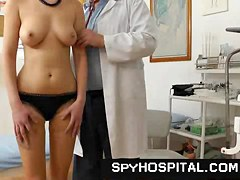Spy web camera movie scene of in nature's garb babe during a physical exam