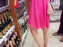 Young Couple Chooses Champagne