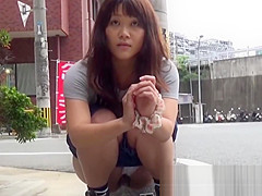 Teenage Asian redhead filmed while peeing on the street