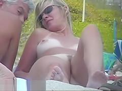 Busty nudist beach caught on a hidden cam