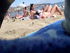 Spying on hawt beach gals
