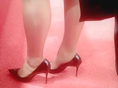 Black skirt Beige stockings Black Louboutins.