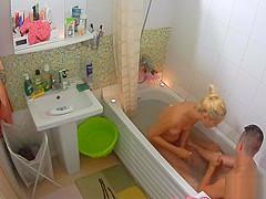 Stunning blonde takes a shower with her boyfriend