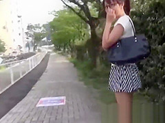 Nerdy Asian cocktease kneels for pissing behind tree