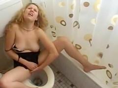 Curly hair blonde masturbates & squirts in bathroom