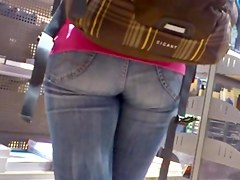 Nice fanny in blue jeans caught in a street candid clip