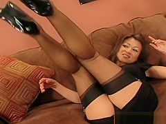Sexy Asian cutie spreads her toes thru her stockings