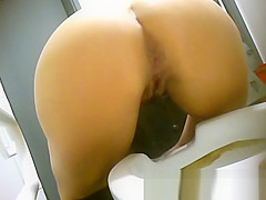 view from behind of women pissing in the toilet