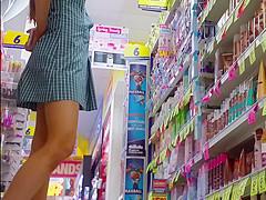 tanned leggy schoolgirl squatting down upskirt