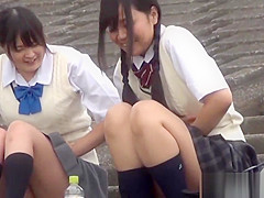 Oriental teenagers urinating in street