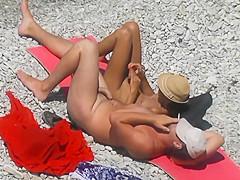 Voyeur. Girl Jerks Off dick her boyfriend at a public beach